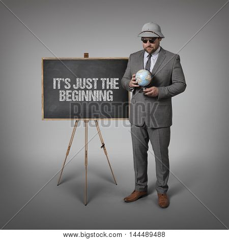 Ist just the beginning text on blackboard with businessman and globe