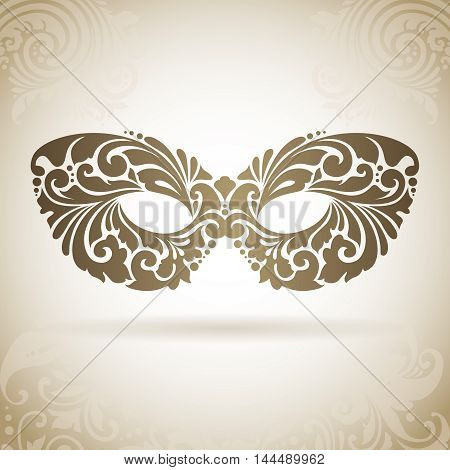 Vintage ornamental mask. Decorative icon on a background with pattern
