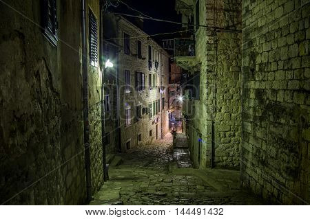 KOTOR MONTENEGRO - 12TH AUGUST 2016: Streets of Old Town Kotor at night showing the outside of buildings.