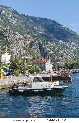KOTOR MONTENEGRO - 12TH AUGUST 2016: A view along the Kotor waterfront during the summer. Showing yachts boats and buildings. People can be seen