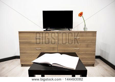 Interior with TV and chest of drawers