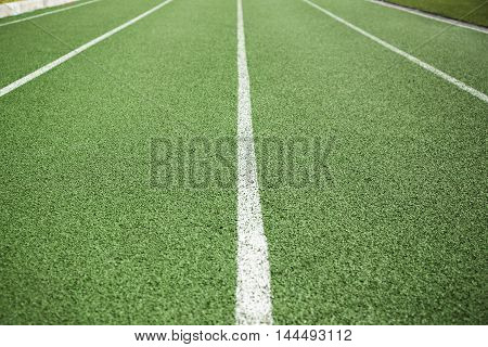 Empty green lanes on a running track