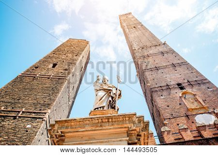 Two famous leaning towers and Petronius statue in Bologna city. Bologna's two leaning towers are the city's main symbol