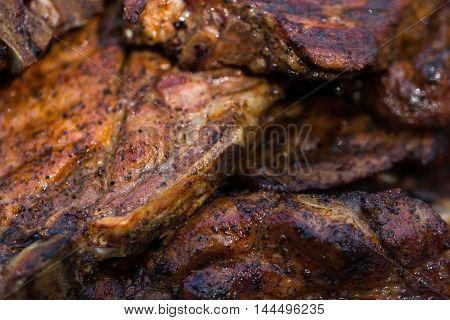 Baked Pork Steak On Bbq Grill Close-up