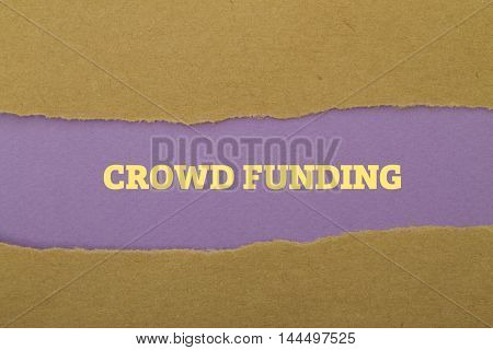 Crowd Funding word written under torn paper.