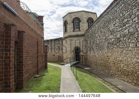 Adelaide, South Australia, Australia - August 14 2016: The hanging tower at the old historic Adelaide Gaol. With an external wall on the right and internal reinforced internal walls to the left.