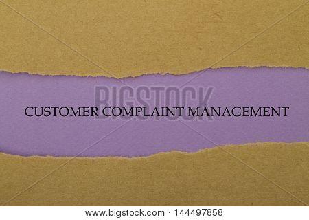 Customer Complaint Management written under torn paper.