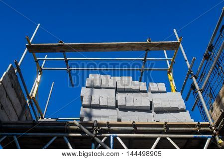 Pile of 'Aircrete' concrete blocks. On a house building site. In England.