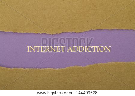 Internet Addiction word written under torn paper .