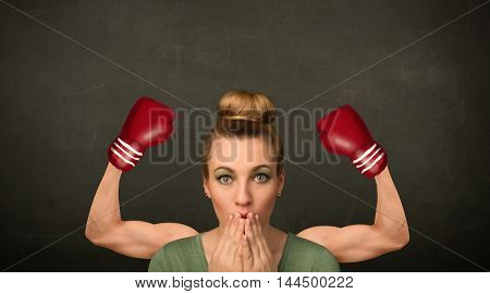 Pretty young woman with strong and muscled boxer arms concept