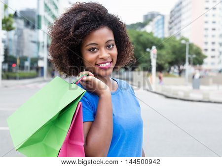 Happy woman with shopping bags in the city
