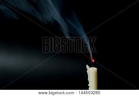 Smoke from extinguished candle. On Black background.