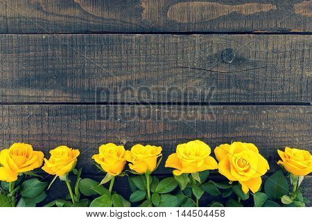 Frame Of Yellow Roses On Rustic Wooden Background. Valentine's Day And Mother's Day Background. Holi