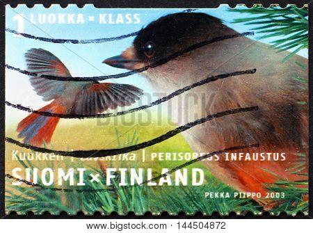 FINLAND - CIRCA 2003: a stamp printed in Finland shows Siberian Jay Perisoreus Infaustus Bird circa 2003