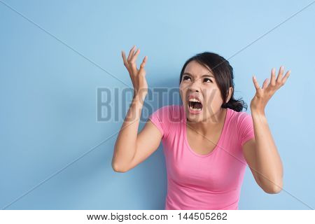 angry asian woman, closeup portrait with copyspace