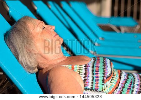 Active Senior Blond Woman Sunbathing