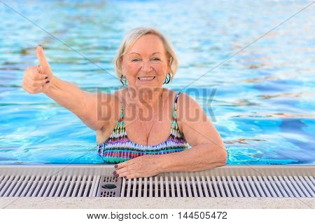 Happy Healthy Senior Woman Giving A Thumbs Up