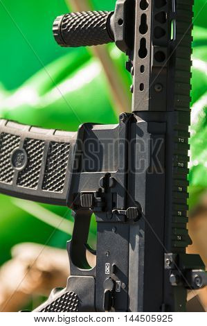 automatic weapon closeup on the green background