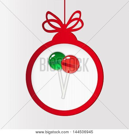 New year clock. Christmas ball and lollipops.