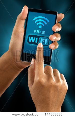 a woman finger connect to a free wifi zone on a smart phone