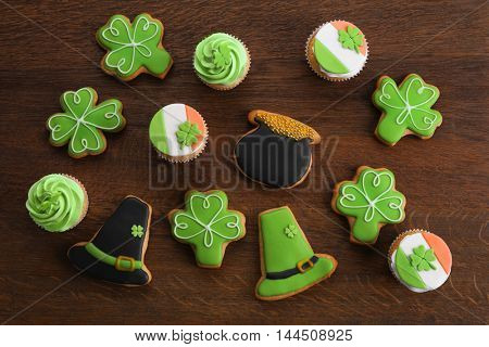 Decorative cookies on wooden background. Saint Patrics Day concept