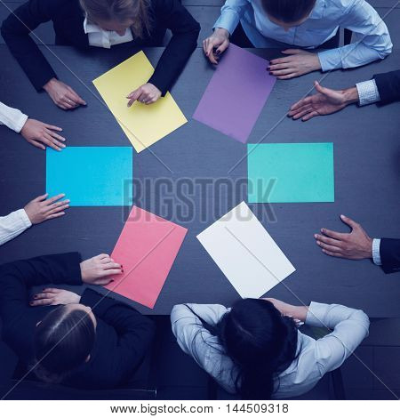 Group of business people with blank colorful paper new project concept