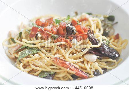 spaghetti or spicy spaghetti in the white dish