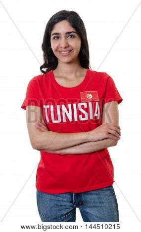 Laughing female sports fan from Tunisia on an isolated white background for cut out