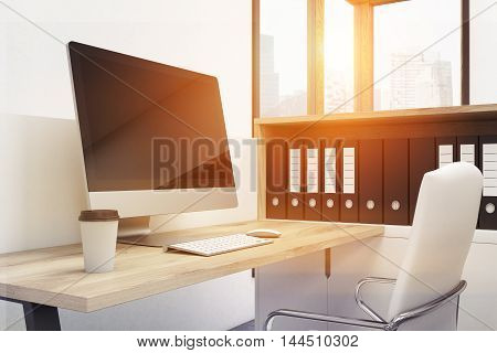 Workplace with desktop computer armchair and bookshelf. Panoramic window with Singapore city view in background. 3d rendering. Mock up. Toned image