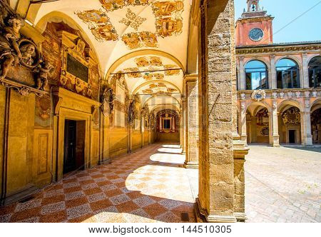 Bologna, Italy - May 23, 2016: Inner yard of Archiginnasio of Bologna that houses now Municipal Library and the famous Anatomical Theatre. It is one of the most important building in Bologna.