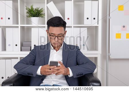 Asian Businessman Checking Mail