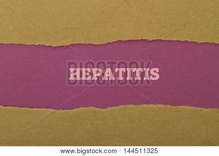 Hepatitis word written under torn paper .