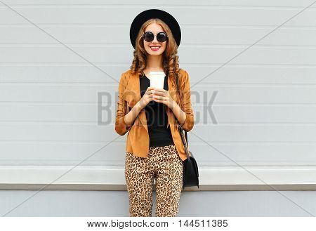 Fashion Happy Young Smiling Woman With Coffee Cup Wearing Retro Elegant Hat, Sunglasses, Brown Jacke