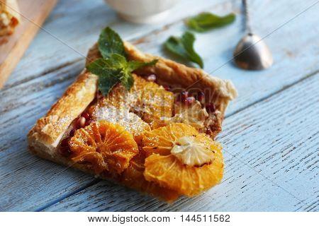 Citrus cake slice on wooden table