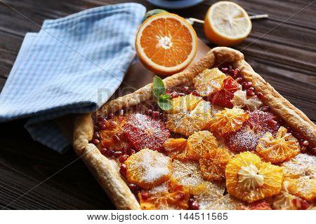 Delicious citrus cake on cutting board