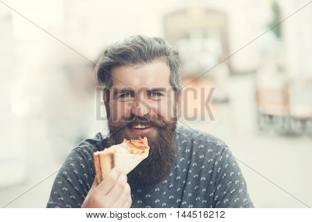Handsome Bearded Man Eating Pizza