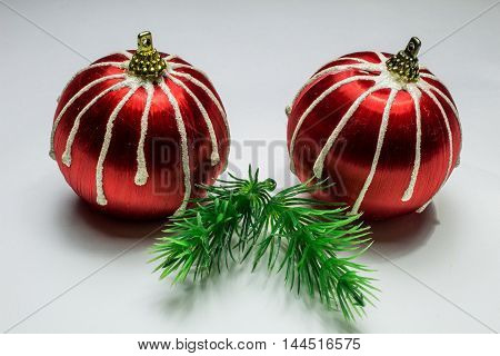 Two Red Stripes Christmas Balls And Fir Branchs