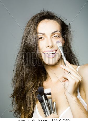 Pretty Woman In Bra With Makeup Brush