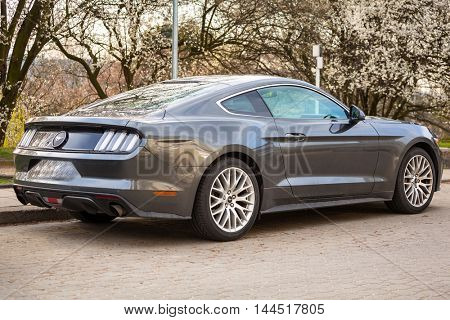 GDYNIA, POLAND - APRIL 8, 2016: Ford Mustang parked up at the city street in Gdynia, Poland. The Ford Mustang is an American automobile manufactured by Ford