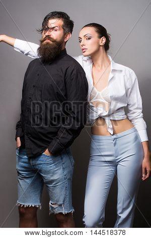 Young Stylish Couple In Studio