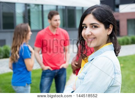 Laughing arabic woman and multiethnic friends outdoor