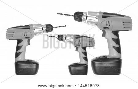 Three Electric Drills on a White Background