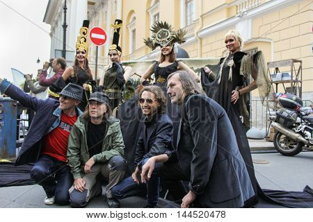 St. Petersburg, Russia - 13 August, The group of men photographed with models,13 August, 2016. Girls model in designer dress posing on the street.