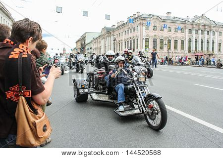 St. Petersburg, Russia - 13 August, Bikers aged tricycle,13 August, 2016. The annual parade of Harley Davidson in the squares and streets of St. Petersburg.