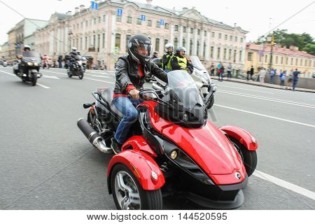 St. Petersburg, Russia - 13 August, Biker tricycle on a green bridge over the Moika River,13 August, 2016. The annual parade of Harley Davidson in the squares and streets of St. Petersburg.