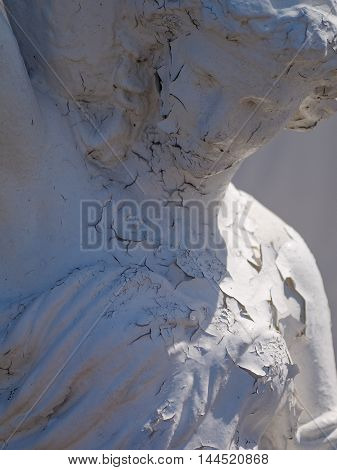 Old Statue of a lady with flaky paint,