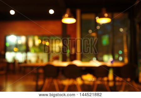 blur chair and table in restaurant or cafe at dark night abstract