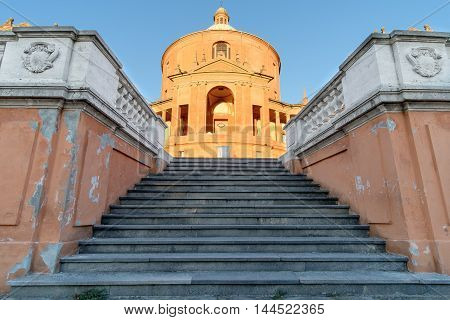 Facade of the Catholic Cathedral of St. Luke on a hillside of Bologna Italy at sunset