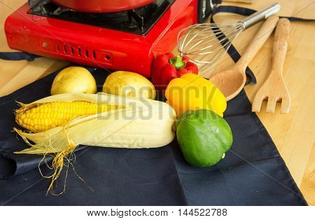 Food Ingredients With Kitchen Utensils For Cooking On Wooden Table