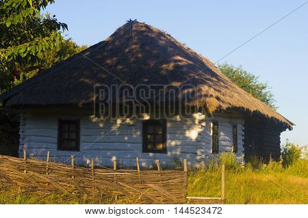 Old Traditional Rural House with Thatch Roof